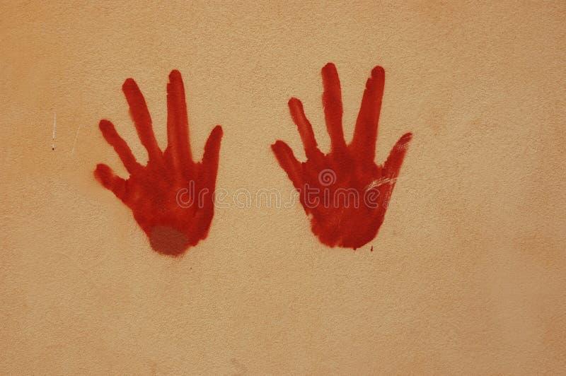 Hände auf Wand stockbild