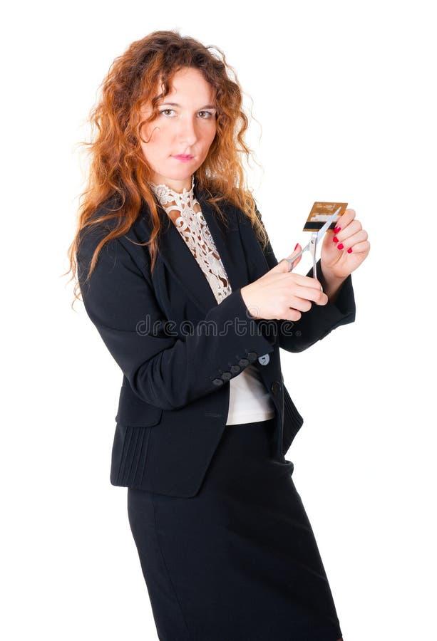 Hände betriebsbereit scissor eine Kreditkarte stockbild