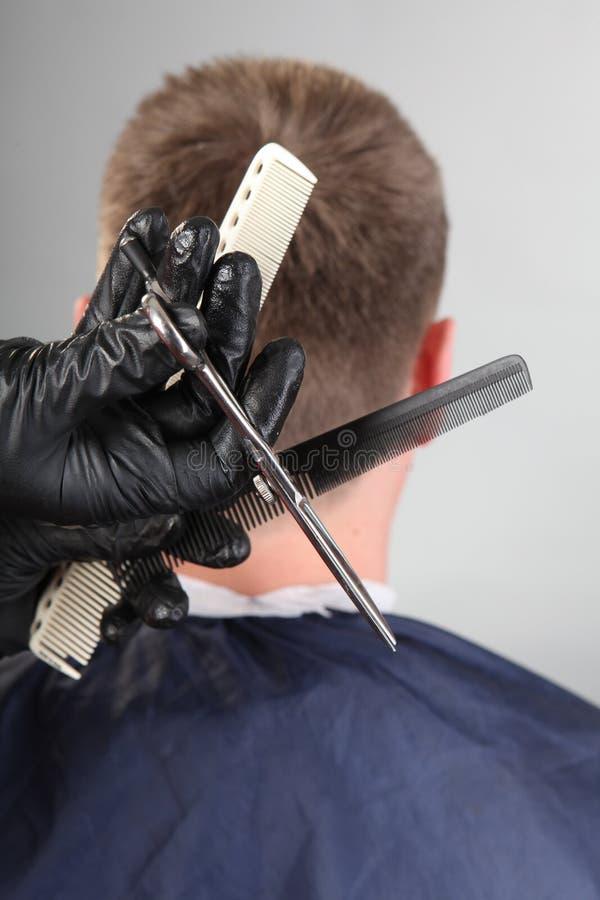 Hände des Meisters, parmenmahera Werkzeuge lizenzfreie stockfotos