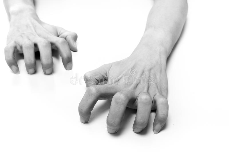Hände, die auf weiße Oberfläche kriechen stockfoto