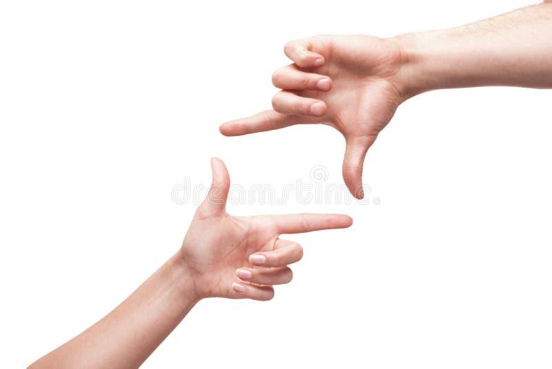 Hände, die einen Rahmen für Einsatztext oder -entwurf bilden lizenzfreie stockfotos