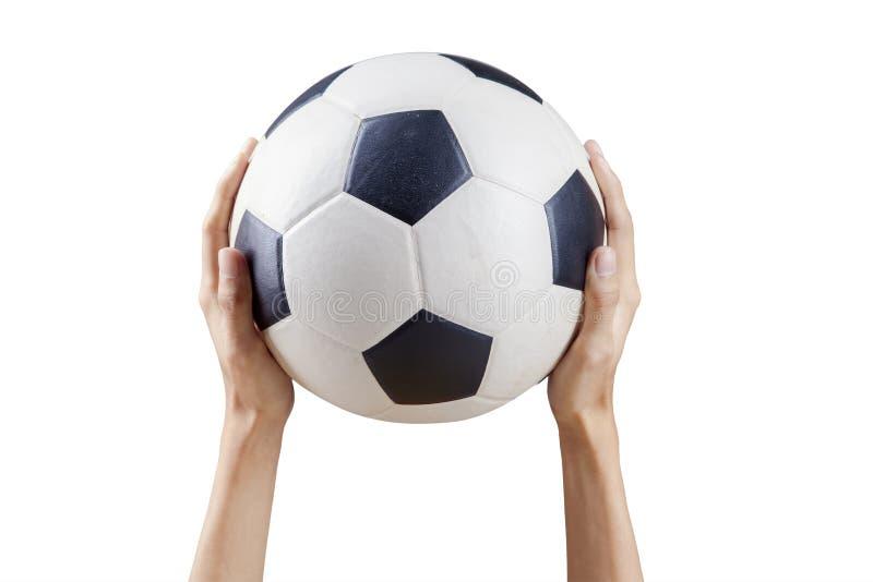 Hände, die Fußball halten stockfoto