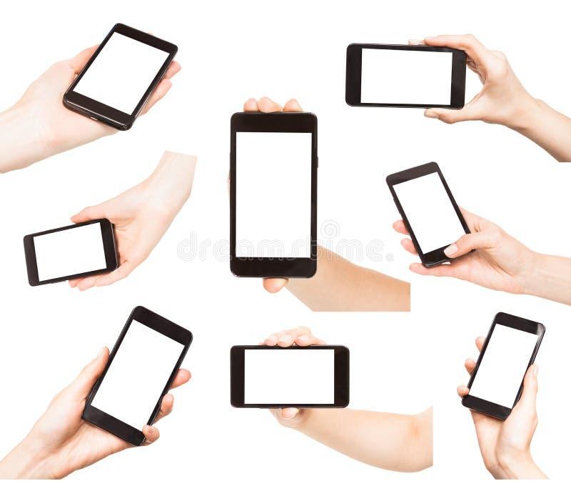Hände, die intelligente Telefone lokalisiert halten lizenzfreies stockfoto