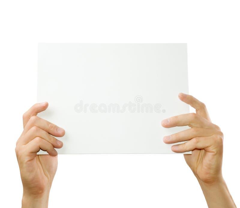 Hände, die Papier halten stockbild
