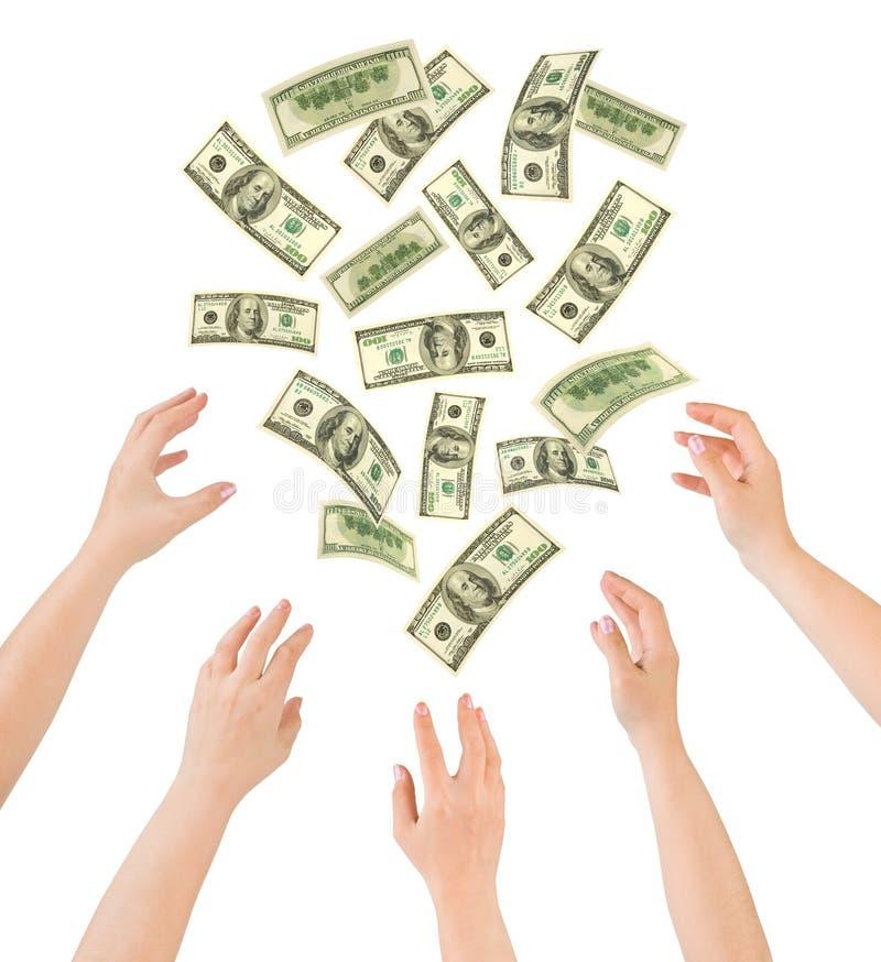 Hände und fallendes Geld stockbild