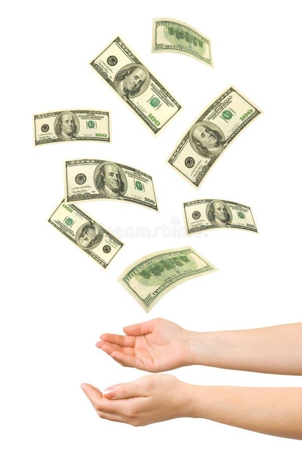 Hände und fallendes Geld stockbilder