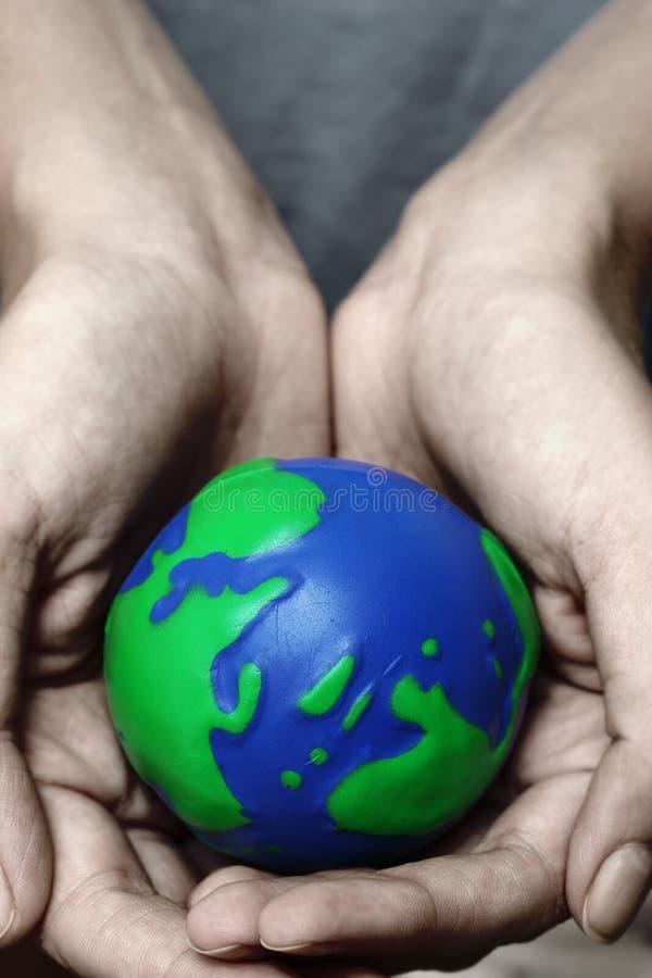 Hände und Planet lizenzfreies stockbild
