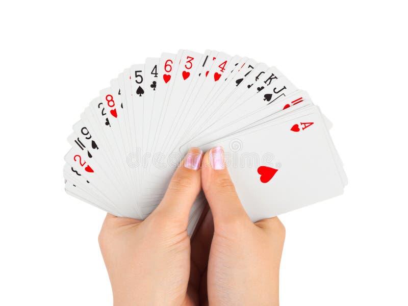 Hände und Spielkarten stockbilder