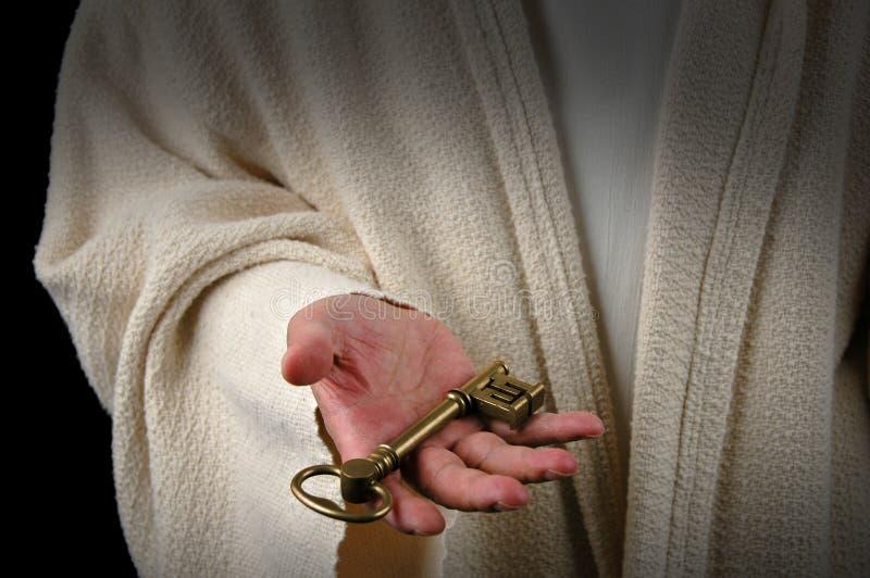 Hände von Jesus und von Taste stockbild