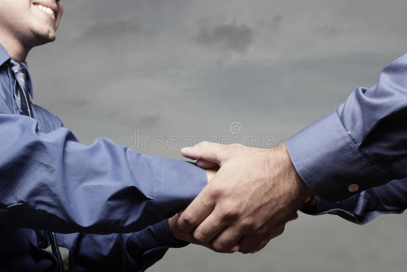 Händedruck stockbild