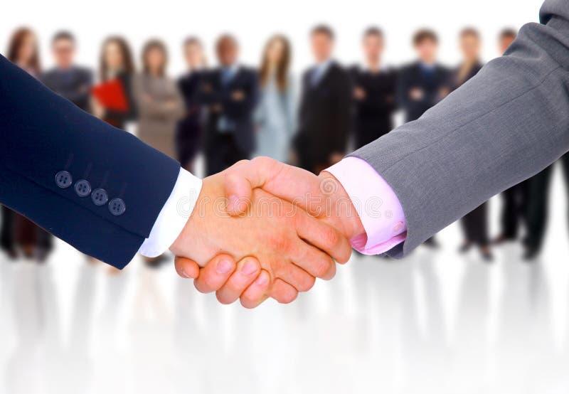 Händedruck getrennt auf Geschäft stockbild