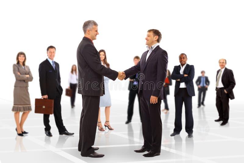 Händedruck getrennt auf Geschäft stockfoto