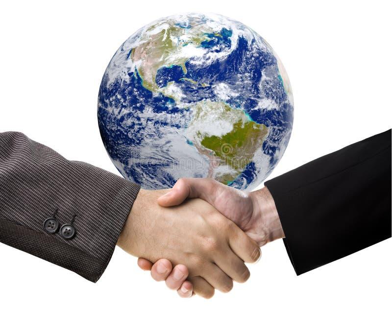 Händedruck und die Erde lizenzfreies stockbild