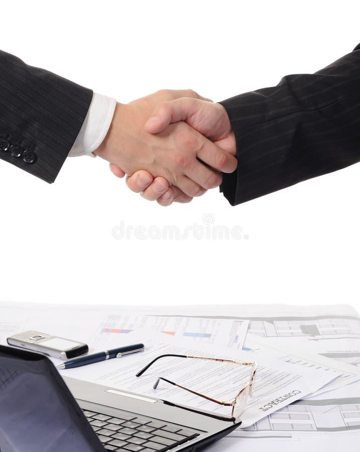 Händedruck von zwei Teilhabern lizenzfreie stockbilder