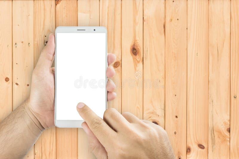 Händer för bästa sikt som rymmer smarta telefoner royaltyfria bilder