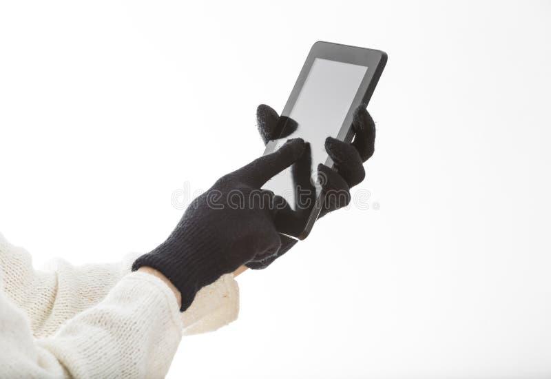 Händer i handskar som trycker på skärmen royaltyfria bilder