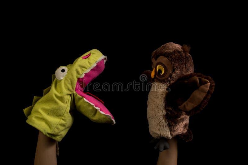 Händer med dockor fotografering för bildbyråer