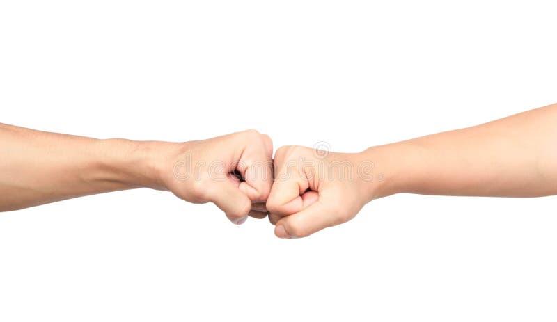 Händer som ger en näve, knuffar till på vit bakgrund arkivfoto
