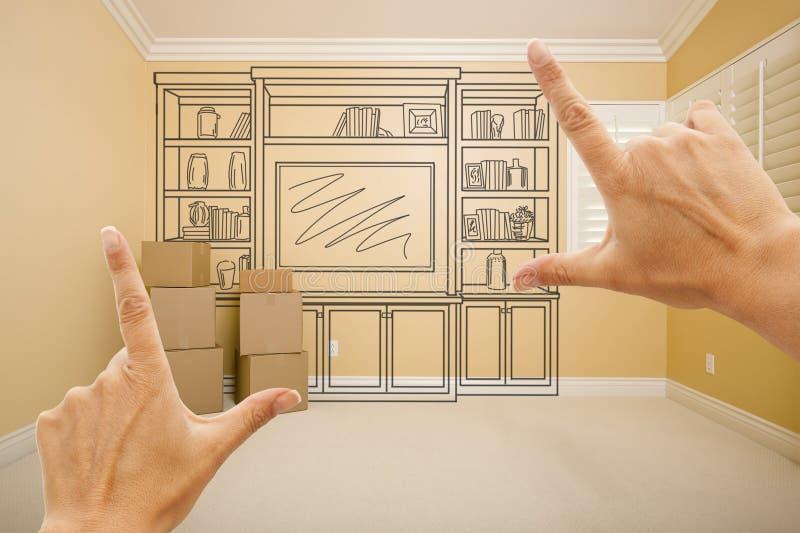 Händer som inramar teckningen av underhållningenheten i tomt rum arkivfoton