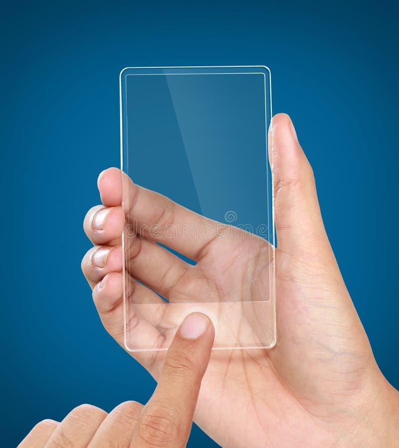 Händer som rymmer den futuristiska genomskinliga mobiltelefonen fotografering för bildbyråer