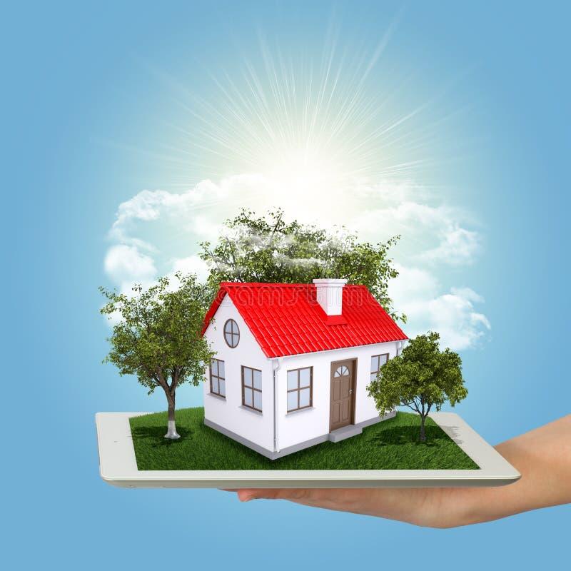 Händer som rymmer minnestavlaPC och det lilla huset med land stock illustrationer