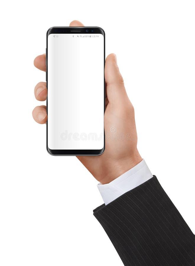Händer som rymmer och använder en modern smartphone royaltyfri fotografi