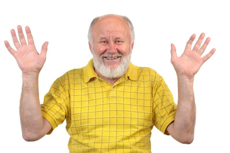 Händer upp och att le den skalliga mannen för pensionär arkivfoto