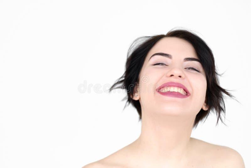 Hänförde lycklig glädje för sinnesrörelseframsidan flickan som strålar leende arkivbilder