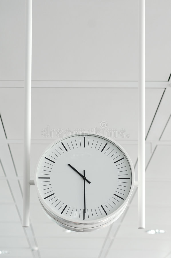 hängande white för klocka royaltyfria foton