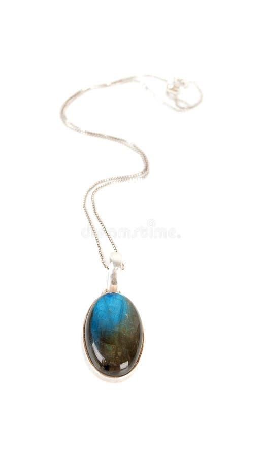 Hänge med en blå gemstone royaltyfri fotografi
