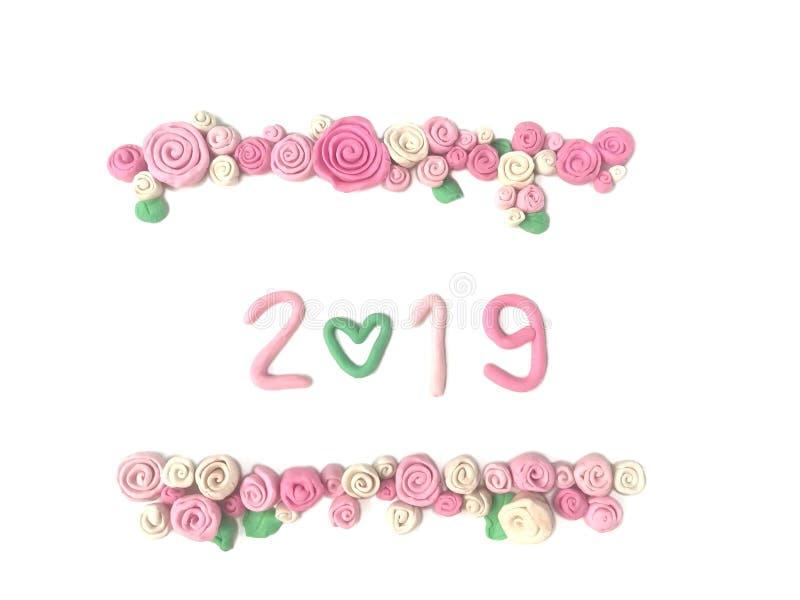 Härlig årsplasticinelera 2019, numrerar 0 hjärtaform, deg för sötsakrosblomma arkivbild