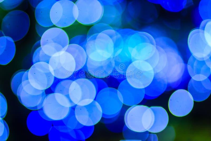 Härlig blå bakgrund för bokehabstrakt begreppljus Underbara Defocu royaltyfri foto