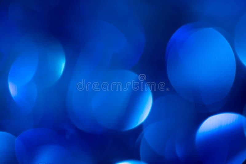 Härlig blå julbokeh Bakgrund arkivbild