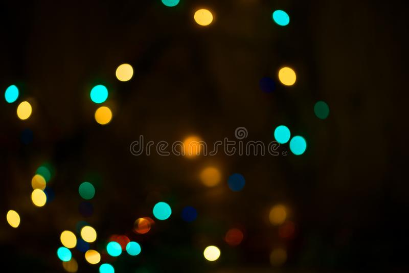 Härlig bokeh på en mörk bakgrund festliga lampor girland D royaltyfri bild