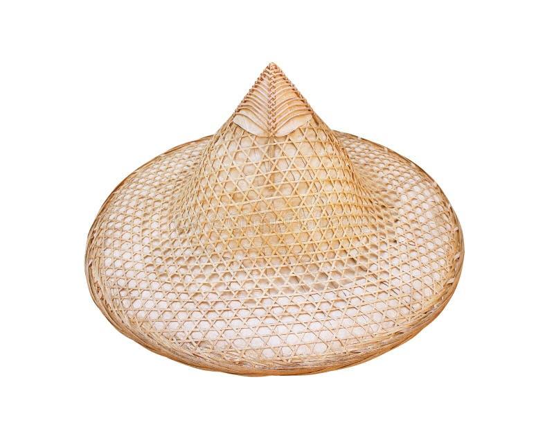 Härlig bondaktig hatt som göras från isolerad vävd bambu på vit bakgrund, hantverk royaltyfria foton