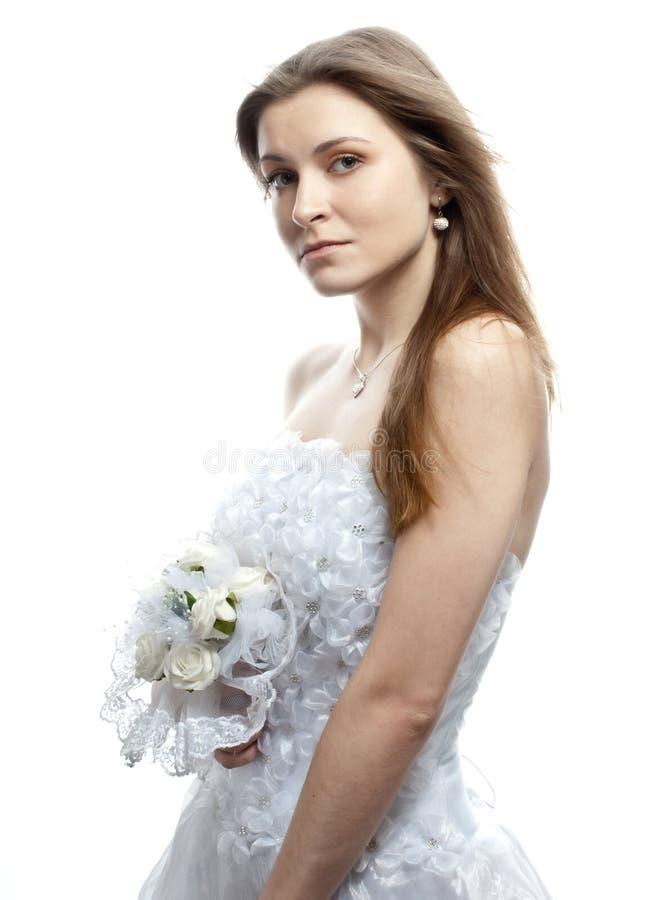 Härlig brud i bröllopsklänning royaltyfria bilder
