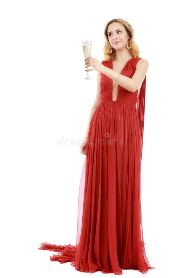 Härlig elegant kvinna i röd klänning med ett exponeringsglas av champagne c royaltyfri foto