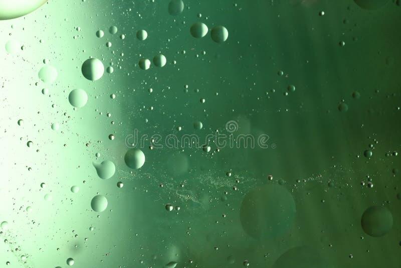 Härlig färgrik bakgrund av olja och vatten arkivbild