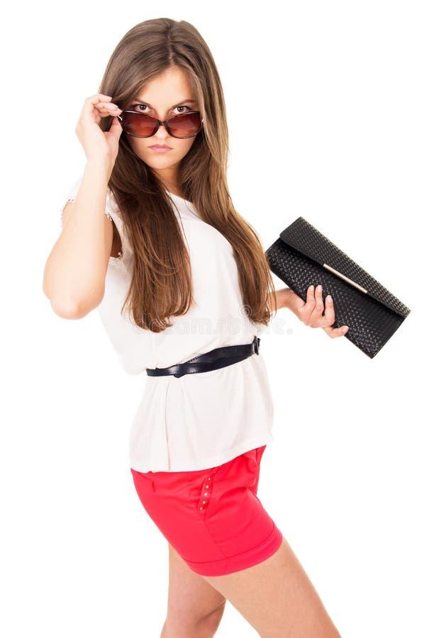 Härlig flicka för glamour i solglasögon fotografering för bildbyråer