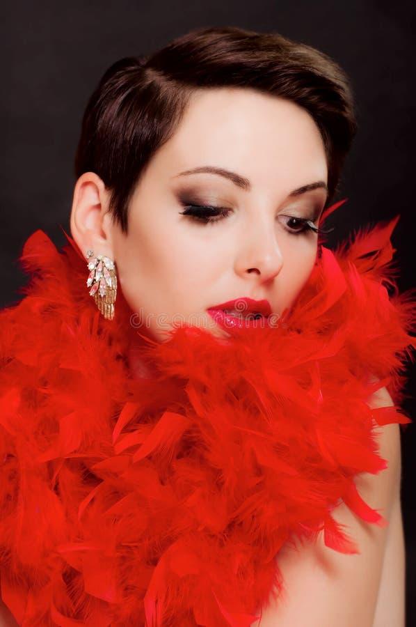 Härlig flicka i boa med makeup royaltyfria foton