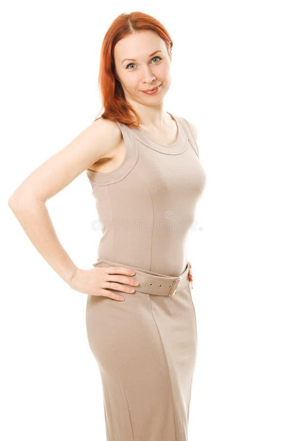 Härlig flicka i den bruna klänningen royaltyfria bilder