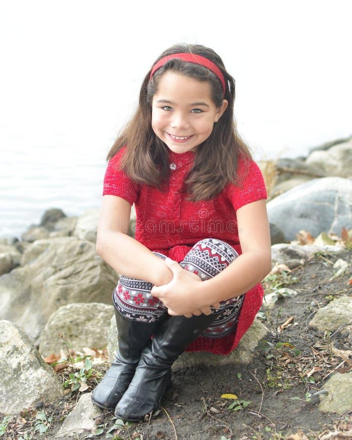 Härlig flicka i rött arkivfoton
