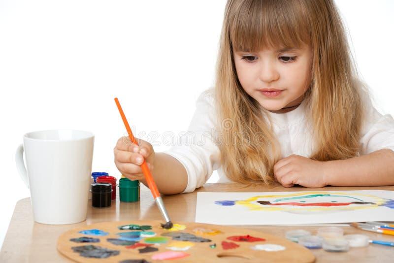 härlig flicka little målning royaltyfri foto