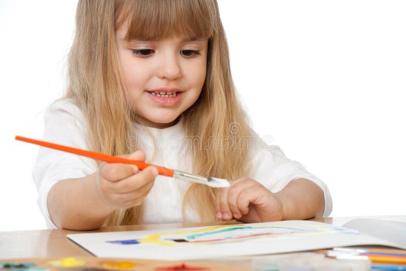 härlig flicka little målning royaltyfri bild