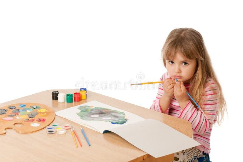 härlig flicka little målning royaltyfria foton
