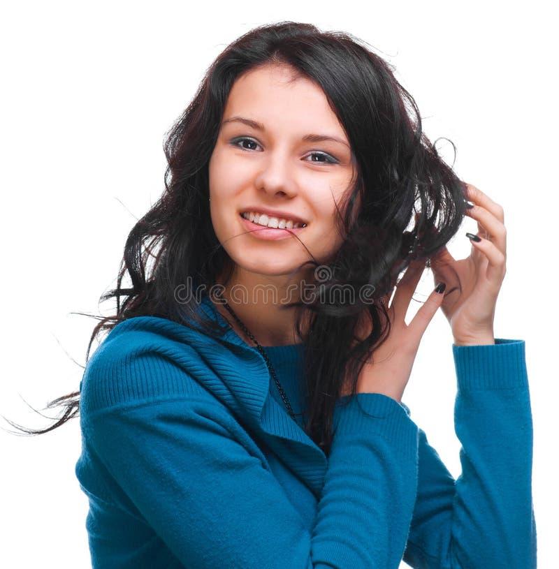 Härlig flicka med flödande hår arkivfoton