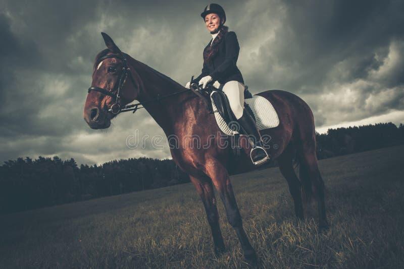 Härlig flicka med hästen royaltyfri bild
