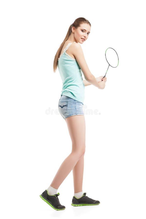 Härlig flicka som spelar med badmintonracket arkivfoton