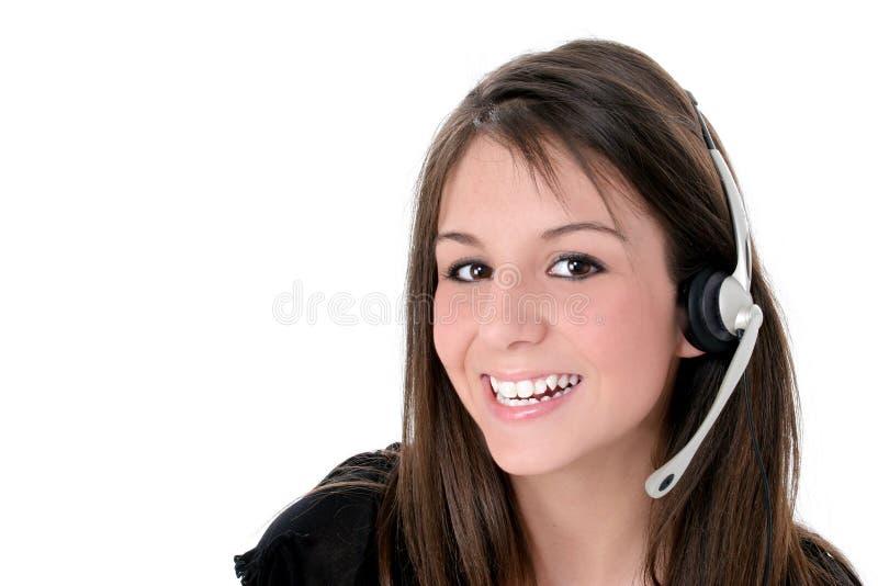 härlig flickahörlurar med mikrofon över teen white royaltyfri bild