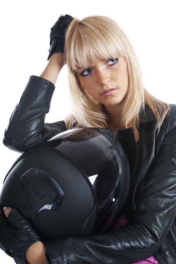 härlig flickahjälmmotorcykel arkivfoto